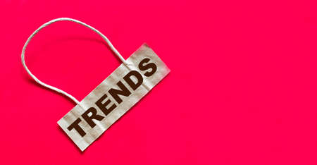 Trends is written on a brown note and a red background. Business concept. 写真素材