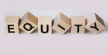 Equity, word written on wooden cubes and white background