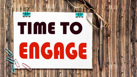 Phrase TIME TO ENGAGE wooden background, top