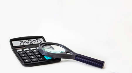 The text of payments is written on the display of the calculator, next to a magnifying glass is not a white background. Place for text.
