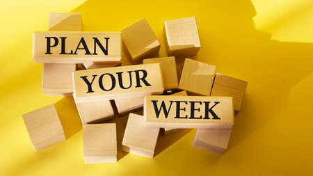 Plan your week, text is written on wooden blocks and on yellow background