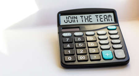 Join our team, the text is written on the display of the calculator. Business concept