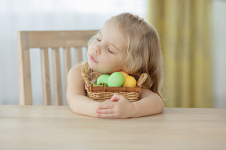 Cute little girl making decoration for Easter. Easter bouquet, eggs, easter, traditions
