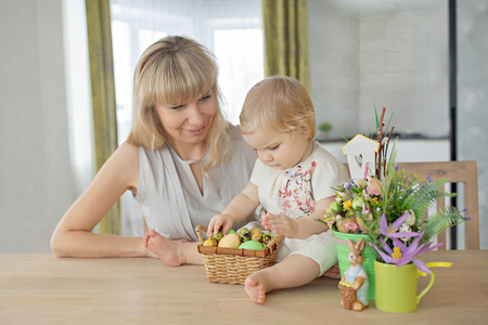 Happy easter! A mother and her daughter painting Easter eggs. Happy family preparing for Easter Stock Photo