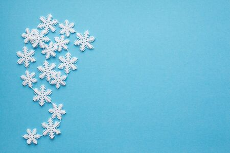 Snowflakes on a blue background with place for text. New year, christmas, holiday Фото со стока