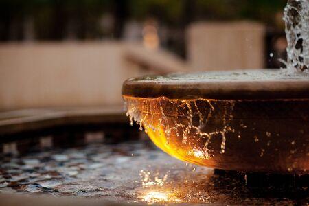 Fantan in a clay bowl, a stream of water Zdjęcie Seryjne