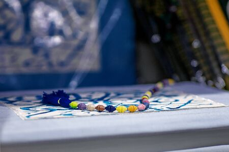 Colorful rosary on a book with arabic ornament Reklamní fotografie - 137590205