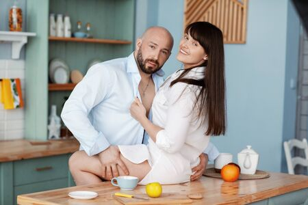 A young couple prepares Breakfast and has a good time in the kitchen. The concept of a healthy lifestyle