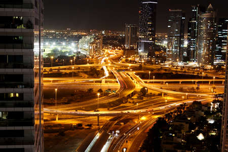Dubai, UAE, November 2019 Night view of a road junction with moving cars against the lights of a modern city