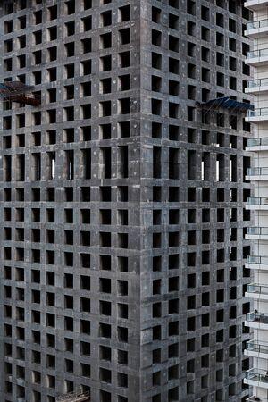 View of a concrete building under construction. Construction, architecture, development