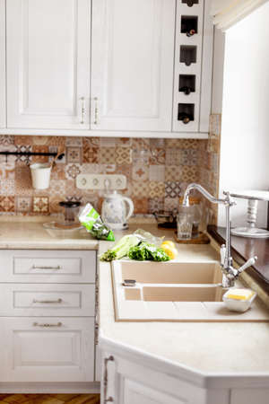 The vegetables are on the table next to the sink. Kitchen faucet, sink, kitchen, vegetables. Healthy food, healthy lifestyle