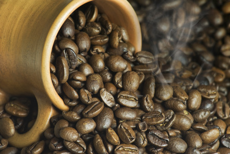 golden bean: coffee with a smoke in a clay jug