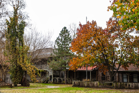 Abandonded old frontier city replica with log buildings in the autumn