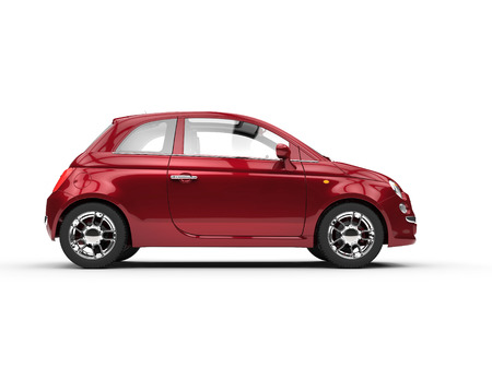 Small cherry colored economic car side Stock Photo