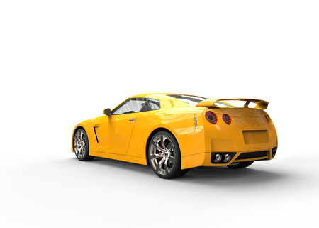 luxury cars: Really fast yellow car back view Stock Photo