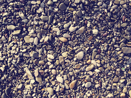 pebblestone: Photo of wet sea beach pebbles With retro filter effect.