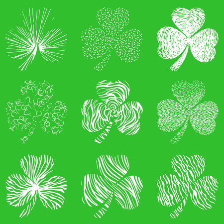 clovers: Vector set of scribbled hand drawn  clovers on green background