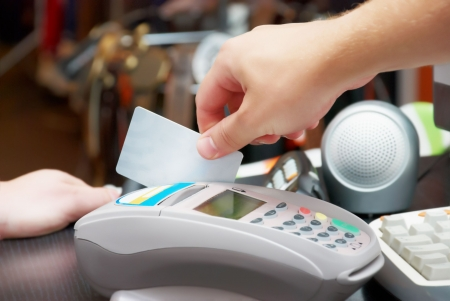 seller hold in his hand a credit card