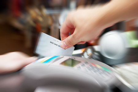 eftpos: seller hold in his hand a credit card
