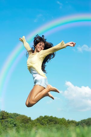 beautiful girl jumping in the park no sky backgroound photo