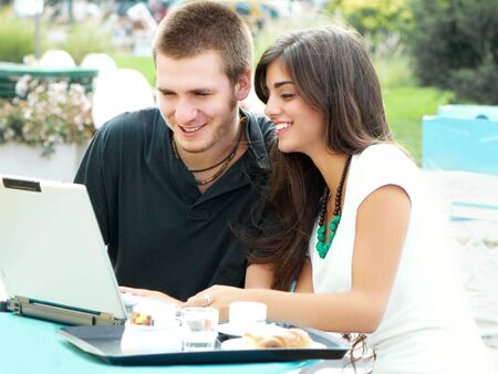 boy and girl working drink coffee and wrking on laptop Stock Photo - 6634578