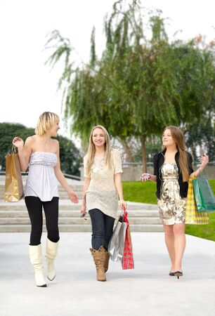 group of friends smiling with shopping bags in the park Stock Photo - 7408446