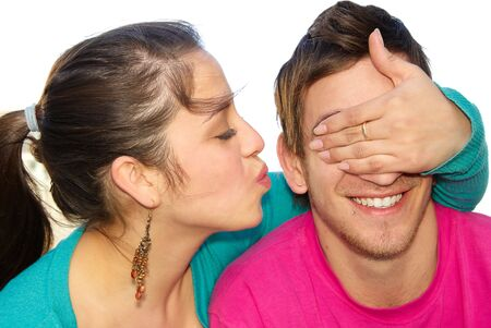 covering eyes: Portrait of a happy woman covering his boyfriends eyes to surprise him