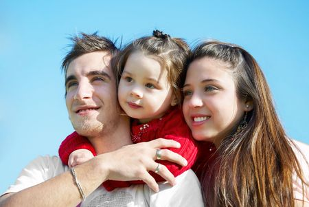 Family of three people plaing in the park photo