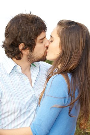 lovers kissing: Lovers kissing in the park Stock Photo