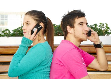 Young beautiful people talk on a mobile telephone  photo