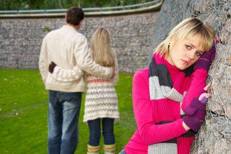 Huilen meisje en paar op een achtergrond Stockfoto - 7720007