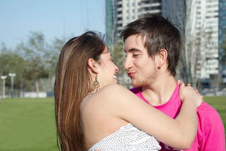 An attractive couple fooling around in the park photo