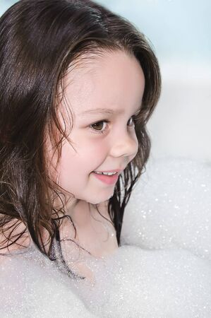 little girl wet and in the foam photo