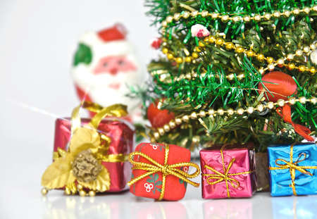 close up of decorated christmas tree with many presents on green background with copy space on right Stock Photo - 8257964