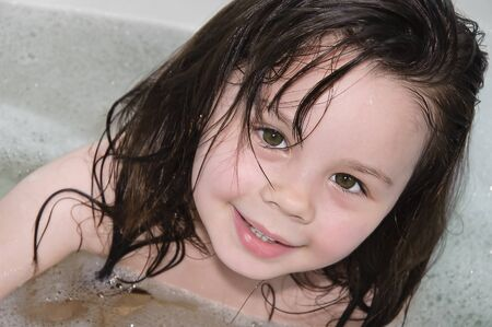 little girl wet and in the foam Stock Photo - 8257950
