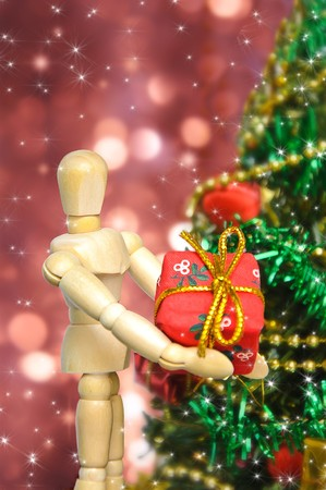 The person character with a box gift on christmas tree background