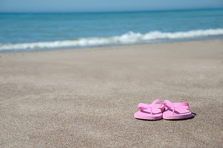 flip flops: Pink flip flops in Turks and Caicos on the beach Stock Photo