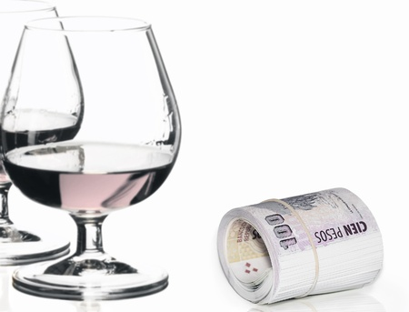 Roll of money and glasses isolated on white background photo