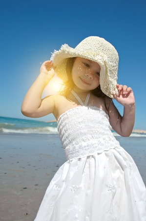 Little girl on the beach wearing funny hat. Stock Photo - 10271284