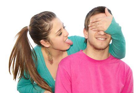 secret love: Portrait of a happy woman covering his boyfriend