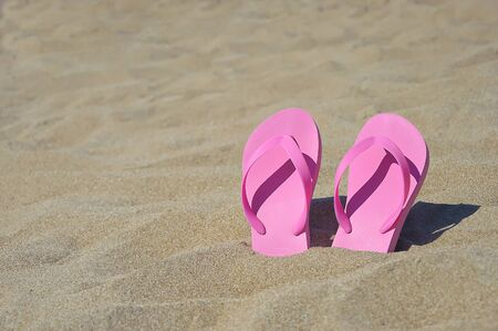 Pink flip flops in Turks and Caicos on the beach photo
