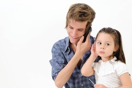 young girl listening a Man talk secretively on cell phone. photo