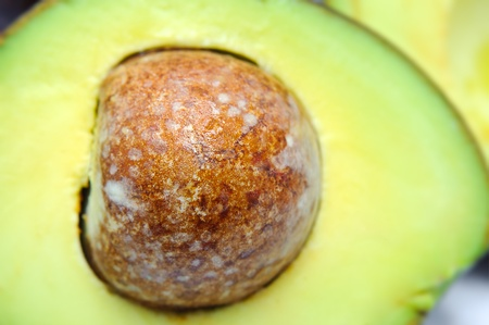 Fresh tropical avocado pear fruit, healthy food on white, macro close up over white  photo