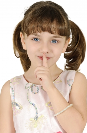 secretive: Little girl gesturing silence sign isolated over white background