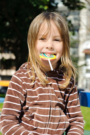 a girl with a brig swirly lollipop  Stock Photo