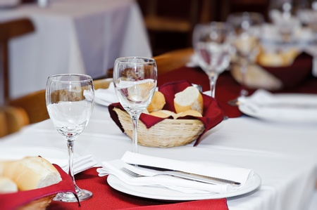 Served table in restaurant interior with copy space photo