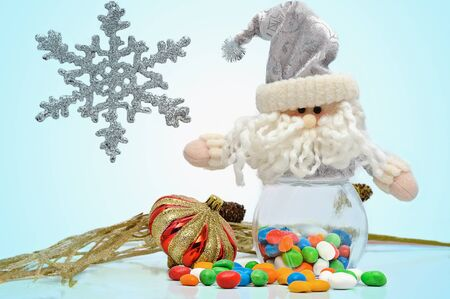 christmas candy and santa isolated on a white background photo