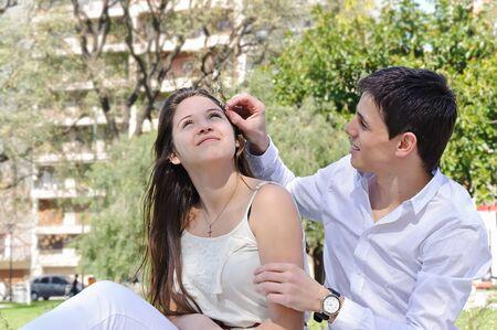 Portrait happy young teenage couple outdoor photo