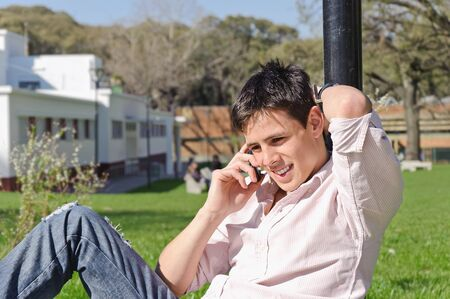 cel: Handsome man outdoors talking on the phone