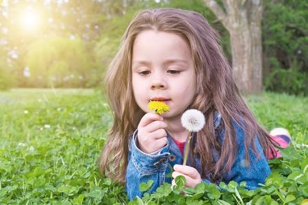 Cute girl in a meadow flower dandelion  photo